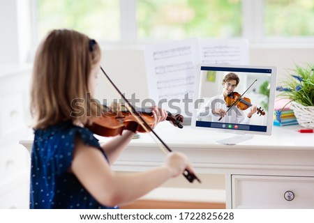 Child playing violin. Remote learning from home. Arts for kid. Little girl with musical instrument. Video chat conference lesson. Online music tuition. Creative children play song. Classical education #1722825628