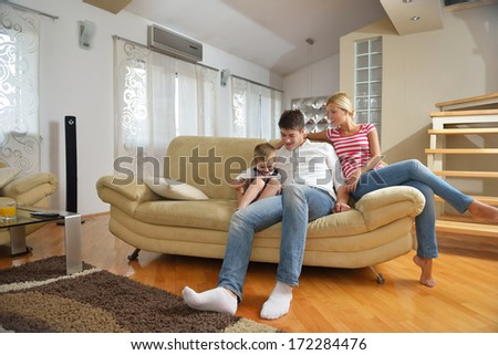 happy young family with kids in bright modern living room have fun #172284476