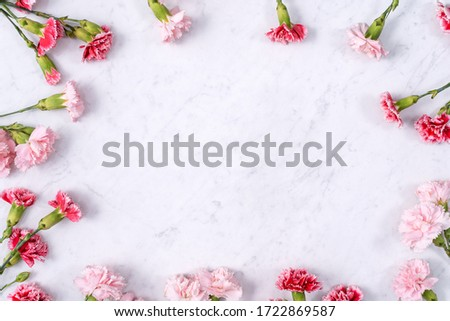 Mother's Day, Valentine's Day background design concept, beautiful pink, red carnation flower bouquet on marble table, top view, flat lay, copy space.