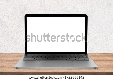 Blank screen laptop computer on wood table top with white wall background, laptop screen die-cut with clipping path.
