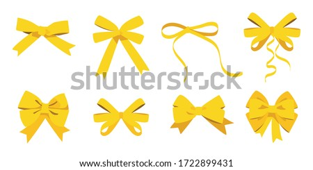 Gold bow set. Cartoon vector yellow ribbons satin bows for xmas gifts, present cards and luxury wrap pack isolated on white background