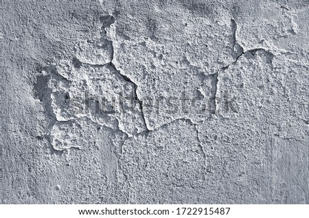 Background of the wall with cracked plaster. #1722915487