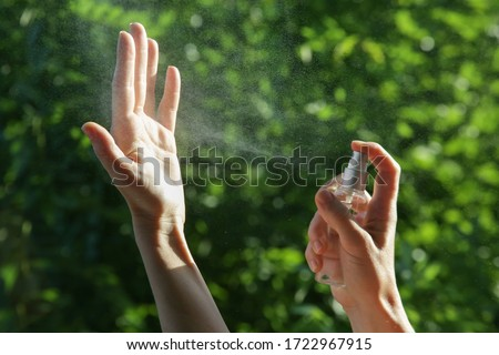 Hands spray. Antibacterial spray for hands. Woman spray hands sanitizer for preventive coronavirus spread. Epidemic prevention, disinfection, skin care concept. Royalty-Free Stock Photo #1722967915