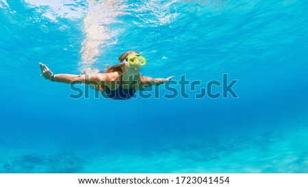Happy family - active young woman in snorkeling mask dive, swim underwater to see tropical fishes in sea lagoon pool. Travel adventure, swimming activity, watersports on summer beach cruise with kid #1723041454