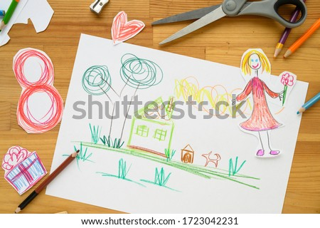 Background for Women's Day. Greeting card international women's day March 8.Children's drawing, colored pencils lie on the table.Number 8 cut from paper on background.Cut from paper. creativity