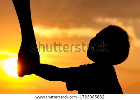 happy dad with a child in the park outdoors silhouette #1723065832