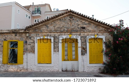 Yellow rustic doors in Samos, Greece #1723071892
