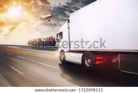 Shipment of goods by sea, by land and by air with cargo ship, truck and airplane at sunset Royalty-Free Stock Photo #1723098151