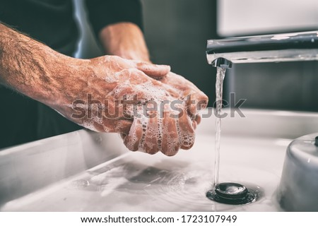 How to wash your hands for COVID-19 prevention. Royalty-Free Stock Photo #1723107949