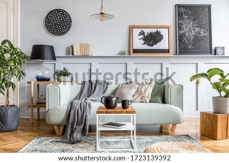 Stylish interior design of living room with modern mint sofa, wooden console, cube, coffee table, lamp, plant, mock up poster frame, pillows, plaid, decoration and elegant accessories in home decor. #1723139392