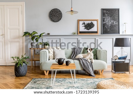 Stylish interior design of living room with modern mint sofa, wooden console, cube, coffee table, lamp, plant, mock up poster frame, pillows, plaid, decoration and elegant accessories in home decor. Royalty-Free Stock Photo #1723139395