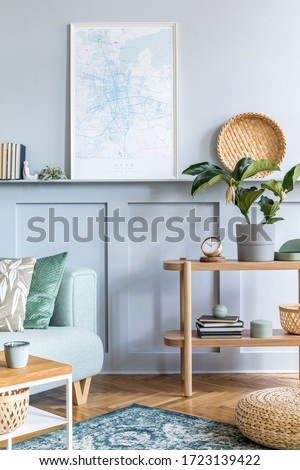 Stylish interior of living room with mock up poster frame, design sofa, coffee table, console, plant, carpet, pillows, plaid, books, clock and elegant personal accessories in modern home decor.