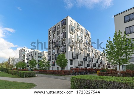 Cityscape of a modern residential area with apartment buildings, new green urban landscape in the city Royalty-Free Stock Photo #1723227544