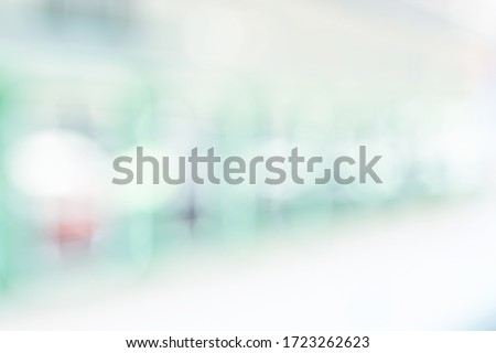 BLURRED OFFICE WITH BOKEH LIGHTS BACKGROUND Royalty-Free Stock Photo #1723262623