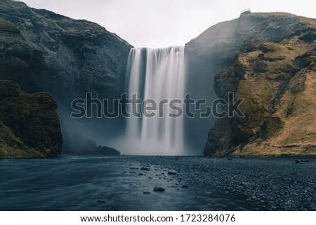 A long exposure photo of Icelandic waterfall called Skogafoss during the COVID outbreak without people Royalty-Free Stock Photo #1723284076