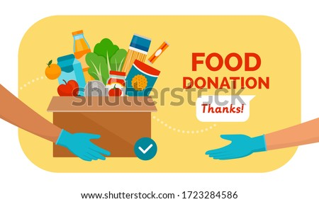 Volunteer holding a donation box with food using protective gloves, charity and solidarity during covid-19 pandemic concept Royalty-Free Stock Photo #1723284586