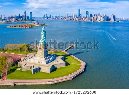 Aerial View of Statue of Liberty, Ellis Island and Lower Manhattan Skyline from New York Harbor near Liberty State Park in New Jersey Royalty-Free Stock Photo #1723292638