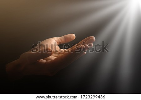 Man hands praying in dark background Royalty-Free Stock Photo #1723299436