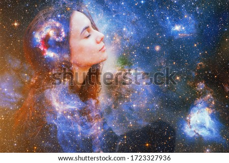 Double exposure portrait of a young woman close eye face with galaxy space inside head. Human inner peace, star light fire, life zen girl love, rpa ai concept. Elements of this image furnished by NASA Royalty-Free Stock Photo #1723327936