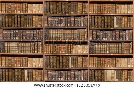 Defocused and blurred image of old antique library books on shelves for use in video conferencing background #1723351978