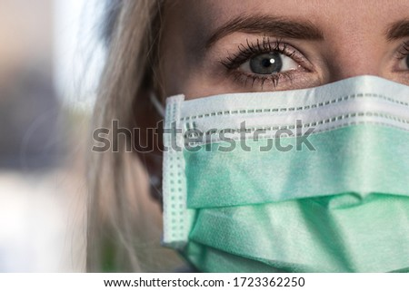 woman with an operation face mask on outdoors #1723362250