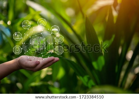 Technology, hand holding with environment Icons over the Network connection on green background. #1723384510