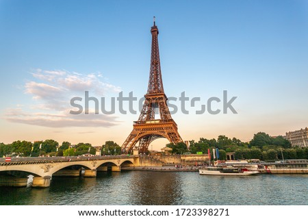 Eiffel Tower at sunset with seine river Royalty-Free Stock Photo #1723398271
