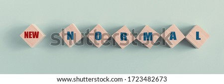 wooden blocks with NEW NORMAL,disruptive innovation way of post covid-19 coronavirus pandemic concept Royalty-Free Stock Photo #1723482673