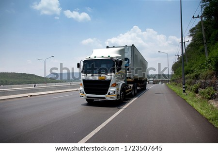 truck transportation on highway for delivery cargo in logistic industry #1723507645