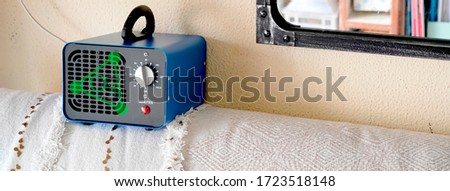 ozone machine, ozone cannon, disinfector converter on a house coach. Covid 19 ozone cleaning with ozone simbol #1723518148