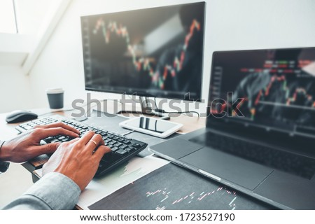 Business man deal Investment stock market discussing graph stock market trading Stock traders concept. Royalty-Free Stock Photo #1723527190