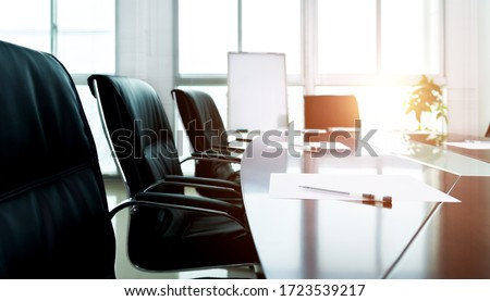 White paper with pen in meeting room. Royalty-Free Stock Photo #1723539217