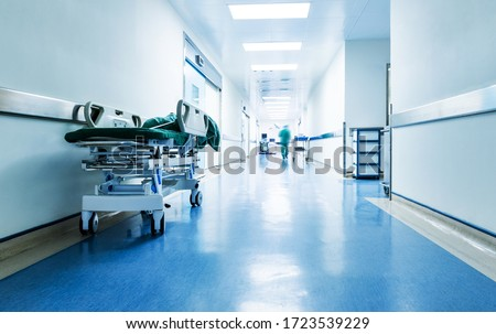 Doctors or nurses walking in hospital hallway, blurred motion. Royalty-Free Stock Photo #1723539229