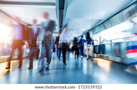 Business people rushing in the lobby. Royalty-Free Stock Photo #1723539322