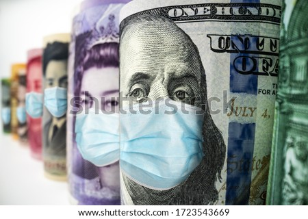Business and money in covid 19 crisis - International money wearing face mask effected by covid 19 outbreak in concept of money saving and money investment under covid 19 situation. Royalty-Free Stock Photo #1723543669