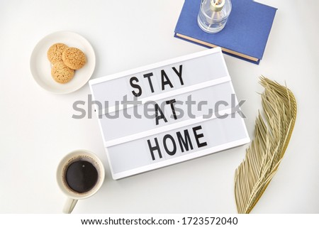 medicine, epidemic and healthcare concept - lightbox with stay at home caution words on white background #1723572040