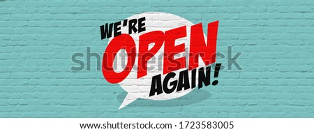 We're open again on speech bubble Royalty-Free Stock Photo #1723583005