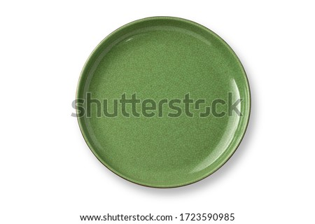 Top view,Antique green plate made of jade and brass. With beautiful patterns, plate tea or coffee and hot water isolated on white background. Royalty-Free Stock Photo #1723590985