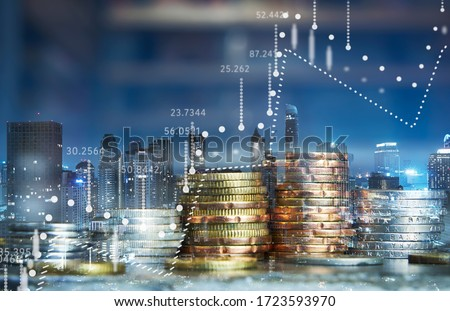Double exposure of coins stack with graph chart and night cityscape. Economic, business, financial and stock market growth concept. Royalty-Free Stock Photo #1723593970