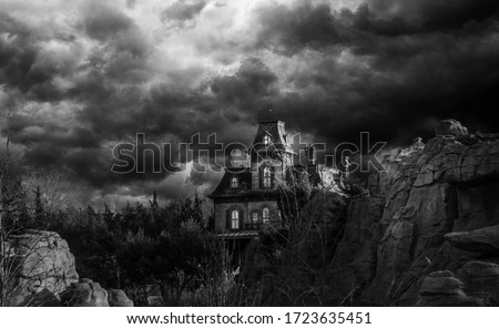 In a stormy weather. Old american type wooden house. Horror house Royalty-Free Stock Photo #1723635451