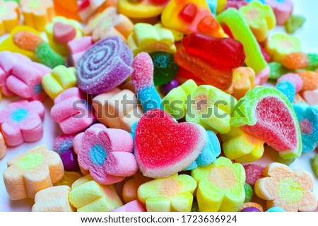 Many colorful lollipops with a sweet flavor placed on the plate.   Royalty-Free Stock Photo #1723636924