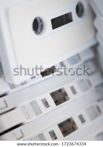 White cassette tapes (compact cassettes or musicassettes, MC). Analog magnetic tape recording format for audio recording and playback. #1723674334