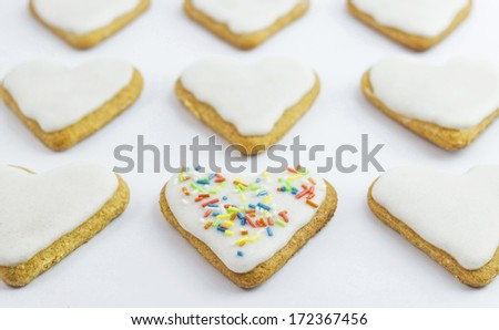 A heart shaped cookie with colorful sweets. #172367456