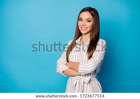 Photo of pretty attractive lady arms crossed calm self-confident chief long groomed hairdo white teeth smile wear striped casual summer spring dress isolated blue color background #1723677514