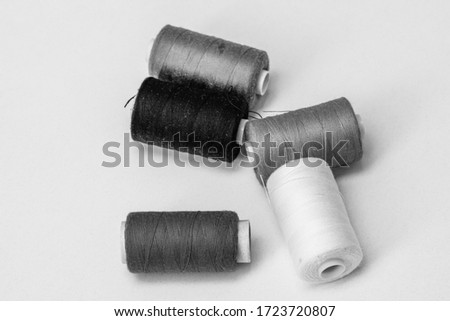 Spools of sewing thread isolated, black and white photo #1723720807