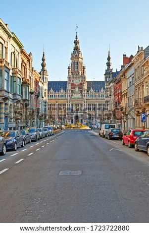 Brussels, Belgium - April 05, 2020: The Royal Saint-Marie street and the communal house at Schaerbeek without any people during the confinement period. #1723722880