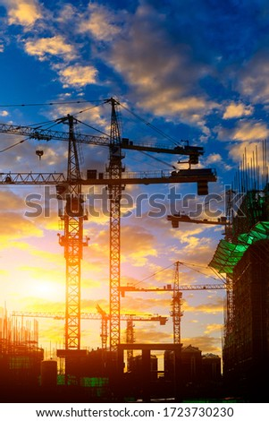 Tower crane and building construction site silhouette at sunrise. #1723730230