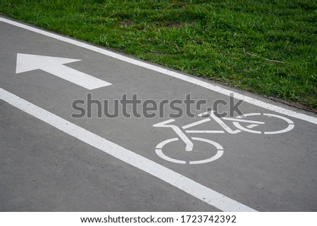 Bike path, a symbol of a Bicycle path on asphalt in a Park. Bike lane Royalty-Free Stock Photo #1723742392