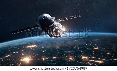 Cargo spaceship on orbit of planet Earth. Expedition on ISS station. Exploration of space. Elements of this image furnished by NASA Royalty-Free Stock Photo #1723754989
