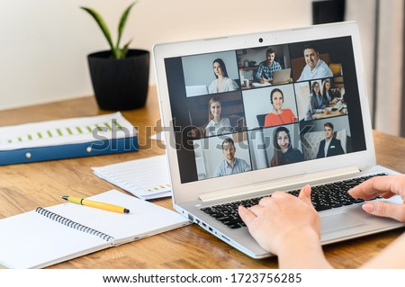 Be in touch from a distance. A laptop application for video call, video connection with many people together, webcam shots on the screen. Female hands are typing on keyboard #1723756285